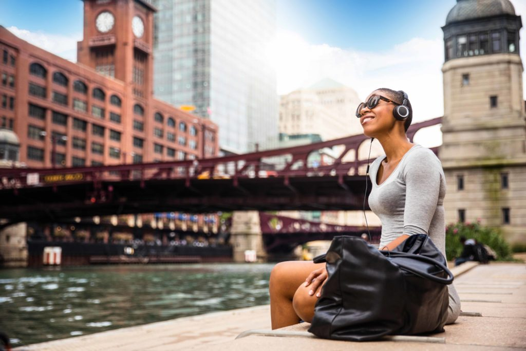 City break in Chicago – Woman relaxing at lunch time